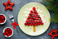 Christmas fun food idea for kids - raspberry Christmas tree. For dessert or breakfast Stock Image