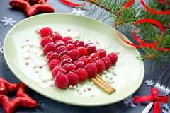 Christmas fun food idea for kids - raspberry Christmas tree. For dessert or breakfast Royalty Free Stock Photography