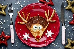 Christmas fun food for kids - reindeer pancake for breakfast. Top view Stock Images