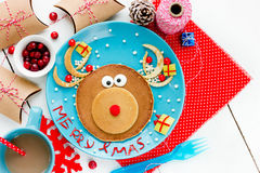 Christmas fun food for kids. Reindeer pancake for breakfast Stock Images