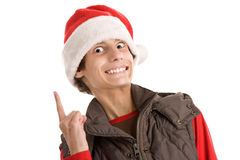 Christmas funny boy. Portrait of christmas boy pointing finger up isolated on white background Stock Image