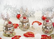 A Christmas funny reindeer with hearts. A Christmas funny reindeer decoration on table with red hearts Stock Photography