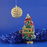 Christmas fur-tree and ball. Stock Image