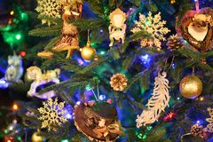 Christmas fur-tree with baubles. The Christmas fur-tree with baubles in a rural interior Royalty Free Stock Photos
