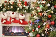 Christmas fur-tree with baubles. The Christmas fur-tree with baubles in a rural interior Stock Images