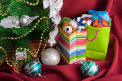 Christmas fur-tree and  packages with gift Stock Photography
