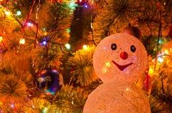 Christmas fur-tree with snowman Royalty Free Stock Photos