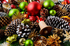 Christmas g background with red ornaments and snowy pine cones stock photo