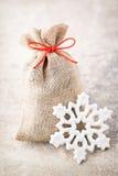Christmas gard. Gift bag with burlap. Christmas decoration. Stock Image