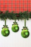 Christmas garland. And ornaments, hanging on the wall Royalty Free Stock Photos