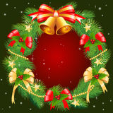 Christmas garland. Decorating Christmas wreath on a dark background Stock Images