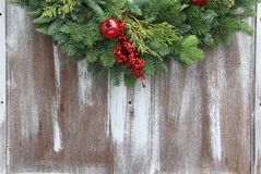 Christmas garland. On a rustic wooden background Stock Image