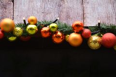 Christmas garland with baubles. And lights Stock Photo