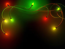 Christmas garland on a black background. Christmas lights on a dark background. Christmas background Stock Images