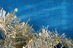Christmas garland. With blue background Royalty Free Stock Photo