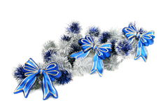 Christmas garland with blue ribbons. Royalty Free Stock Images