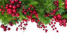 Christmas Garland Border with Red Berries Over White. Christmas garland border with red berries, isolated on white Royalty Free Stock Image