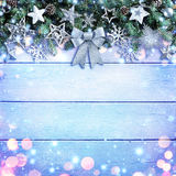 Christmas Garland With Bow And Silver Ornament On Wooden Background. Christmas Garland With Bow And Silver Ornament On Wooden Royalty Free Stock Image