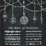 Christmas garland brushes,balls.Chalkboard Royalty Free Stock Photos