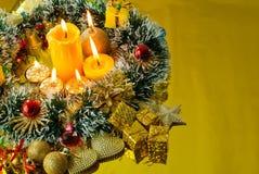 Christmas garland and burning candles Royalty Free Stock Photos