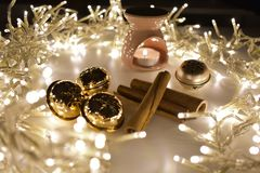 Christmas garland with candles, cinnamon and gold toys stock photography