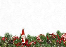 Christmas garland with candy cane and fir-tree on white background. Greeting card royalty free stock images