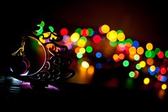 Garland electric New Year`s Eve. Christmas garland with a Christmas tree on a dark background Stock Photo