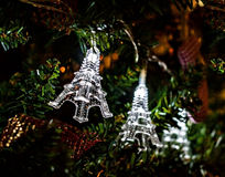 Christmas garland on a Christmas tree Eiffel Towers.  Royalty Free Stock Image