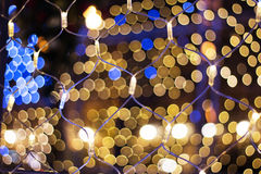 Christmas garland. Colorful bokeh with Christmas garland Royalty Free Stock Photos