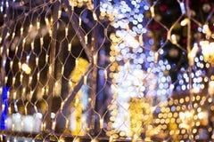 Christmas garland. Colorful bokeh with Christmas garland Stock Photo