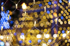 Christmas garland. Colorful bokeh with Christmas garland royalty free stock photo