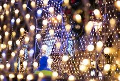 Christmas garland. Colorful bokeh with Christmas garland Royalty Free Stock Image