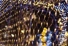 Christmas garland. Colorful bokeh with Christmas garland stock photos