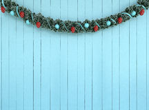 Christmas Garland Decorationon on aqua wood background Stock Photography