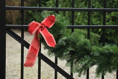Christmas garland on fence Royalty Free Stock Photography