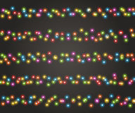 Christmas garland for festive decoration, realistic luminous bulbs. Light effects. Fairy lights for festive decoration, realistic luminous bulbs. Colourful Royalty Free Stock Photos