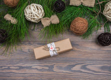 Christmas garland of fir branches and gift on wooden background Stock Photography