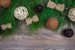 Christmas garland of fir branches with handmade ornaments on wooden background Stock Image