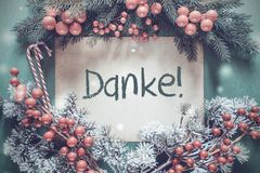 Christmas Garland, Fir Tree Branch, Danke Means Thank You. Brown Paper With German Text Danke Means Thank You. Christmas Garland With Fir Tree Branch And Red stock image