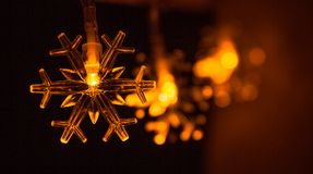 Christmas garland in the form of snowflakes Stock Photos
