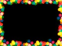 Christmas garland frame. Colorful garland lights - frame over black background stock photo