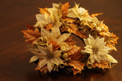 Christmas Garland with golden bronze and white flowers and leafs Royalty Free Stock Images
