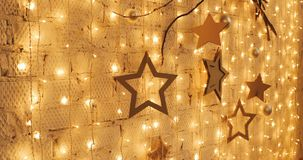 Christmas garland with Golden lights, close-up. Blinking Christmas stars Lights Twinkling. Winter Holidays Concept. Christmas garland with Golden lights, close stock video footage