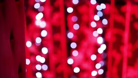 Christmas garland with Golden lights, close-up. Blurred Christmas lights. Bokeh. stock footage