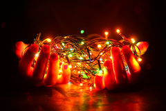 Christmas garland in the hands Stock Image