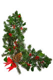 Christmas garland L shaped with bow isolated. Photo of a Christmas garland in an L shape with holly, red berries, ivy, spruce, pine cone and a red bow. Isolated Royalty Free Stock Photos