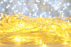 Christmas garland on light background, closeup. Glowing Christmas garland on light background, closeup Stock Images