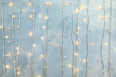 Christmas garland on light background. Glowing Christmas garland on light background royalty free stock photos