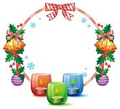 Christmas garland and lighted candle. Royalty Free Stock Photography