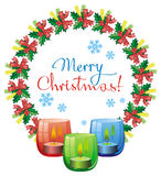 Christmas garland, lighted candle and holiday greeting text. Royalty Free Stock Photo